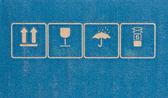 Fine image close-up of fragile symbol on cardboard. — Stock Photo