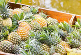 Heap of pineapples at floating market. — Stock Photo
