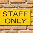 Staff only sign on brick wall. — Foto de Stock