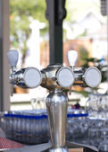 Beer taps at the restaurant. — Stock Photo