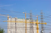 Construction site with crane and eletronic post — Stock Photo