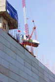 Construction site with crane and building. — Stock Photo