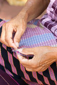 Asian woman's hand sewing. — Stock Photo