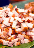 Crispy pork with banana leaves. — Stock Photo