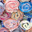 Rolls of colorful fabric. — Stockfoto