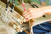 Silk weaved machine with hand. — Stock Photo
