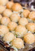 Takoyaki ball the Japanese sweetmeat at food market. — Stock Photo