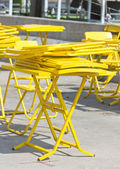 Yellow fold tables and chairs. — Stock Photo
