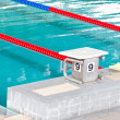 Swimming pool with starting block. — Stock Photo #32565351