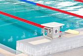 Swimming pool with starting block. — Stock Photo