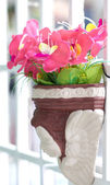 Artificial flowers in clay pot. — Stock Photo