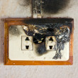 Burned plug socket. — Stock Photo