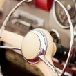 Stock Photo: Steering wheel on classic car.
