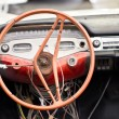 Stock Photo: Damaged vintage steering wheel car.