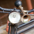 Stock Photo: Vintage bicycle horn on handlebar.