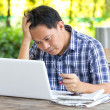 Stress Asian man looking at laptop. — Stock Photo