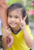 Little Asian Girl Showing Victory Sign. — Stock Photo