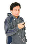 Asian Man Listening Music From Smartphone Isolated on White. — Stock Photo