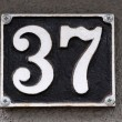 House number on a wall — Stock Photo