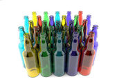 Bottles of colored glass empty grouped — Stock Photo