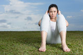 Chinese woman doing situps in park. — Stock Photo