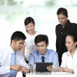 Stock Photo: Asian business having a meeting