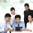 Stock Photo: Asibusiness having meeting