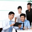 Business colleagues looking at a touchpad — Stock Photo