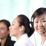 Happy Asian customer service woman — Stock Photo #12320412