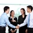 Businessmen shaking hands — Stock Photo #12320454