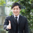 Asian business man ready to shake hands. — Stock Photo