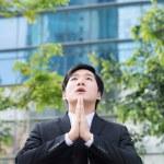Asian Businessman praying for success — Stock Photo