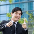 Royalty-Free Stock Photo: Businessman with thumbs up.