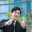 Businessman with thumbs up. — Stock Photo