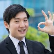 Asian business man gesturing okay — Stock Photo