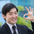 Royalty-Free Stock Photo: Asian business man gesturing okay.