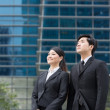 Royalty-Free Stock Photo: Asian business team outside office building.
