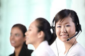 Happy Asian customer service woman — Stock Photo