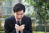 Stressed Asian businessman screaming. — Stock Photo