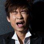 Fashionable Asian man wearing stylish suit — Stock Photo