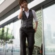 Asian business man talking on a phone. — Stock Photo