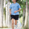 Asian man jogging. — Stock Photo