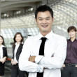 Business man with colleagues in the background — Stock Photo