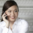 Asian Business woman using a Cell Phone — Stock Photo #12337151