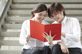 Asian Business reading a document — Stock Photo