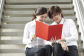 Asian Business man and woman reading a document — Stock Photo