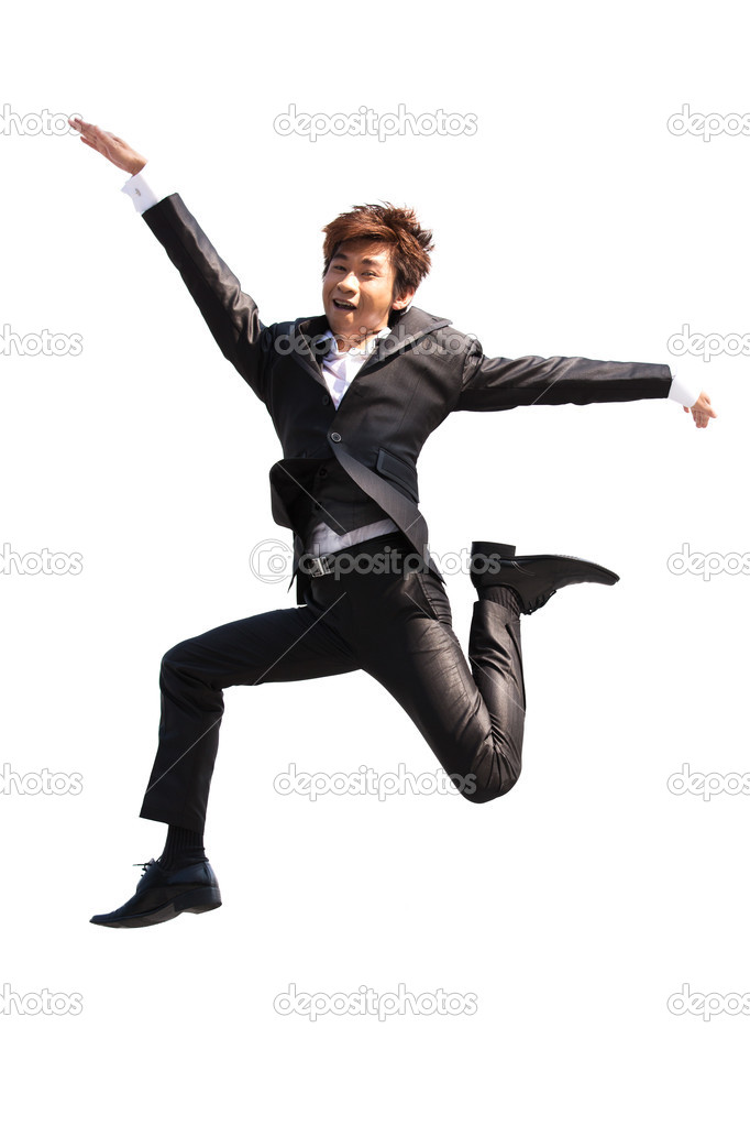 Asian business man jumping while wearing a suit.  Stock Photo #12336658