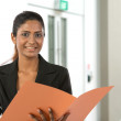Stock Photo: Happy Indian businesswoman witha document.