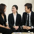 Stock Photo: Business colleges having a meeting