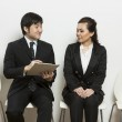 Chinese business man interviewing female applicant. — Stock Photo #16895751